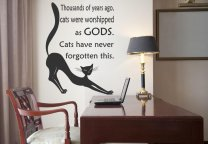 Thousands of years ago, cats were worshipped as gods. Cats have never forgotten this. QUOTE WALL STICKER