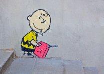 Charlie Brown Firestarter by Banksy